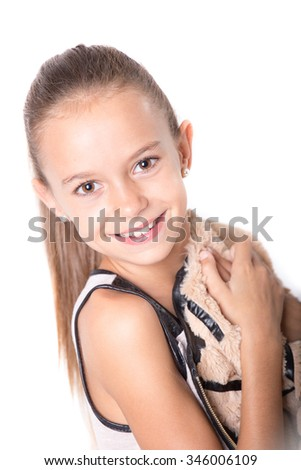 Closeup portrait of a happy young girl smiling - stock photo