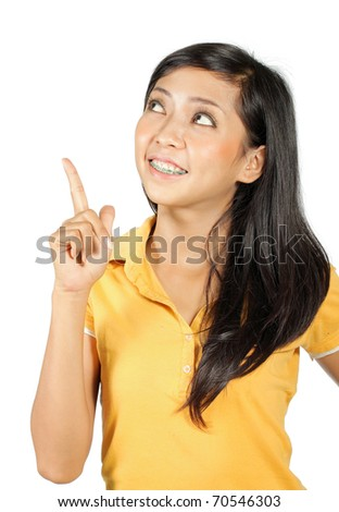 Closeup portrait of a happy young woman smiling - stock photo