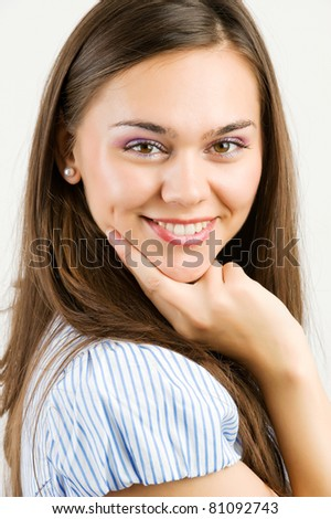 Closeup portrait of a happy young woman smiling -  isolated in white