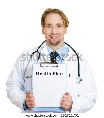 Closeup portrait of a health care professional, smiling, friendly doctor with stethoscope, holding a sign which says health plan and showing space for text, isolated on white background. Obamacare