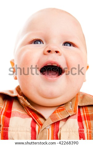 Closeup portrait of a laughing baby boy - stock photo