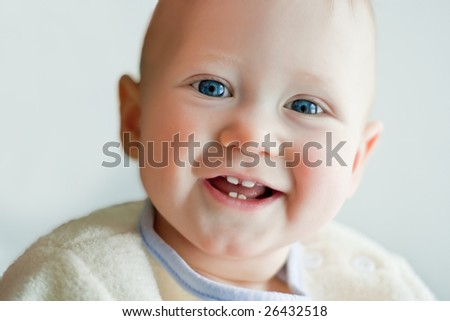 closeup portrait of a little boy with blue eyes - stock photo