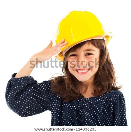 Closeup portrait of a little girl wearing yellow helmet salute - stock photo
