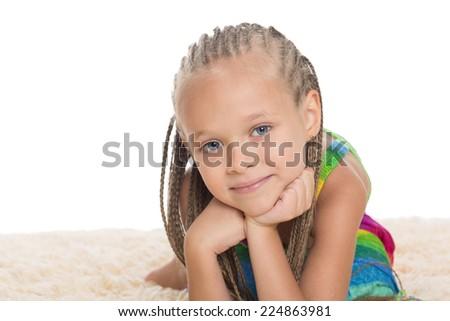 Closeup portrait of a little girl with dreadlocks. Girl six years.  - stock photo