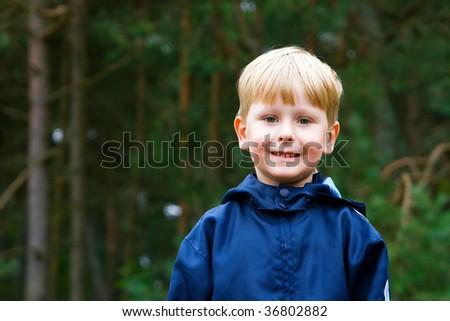 closeup portrait of a little smiling boy - stock photo
