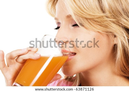 Closeup portrait of a lovely blonde drinking fresh juice - stock photo