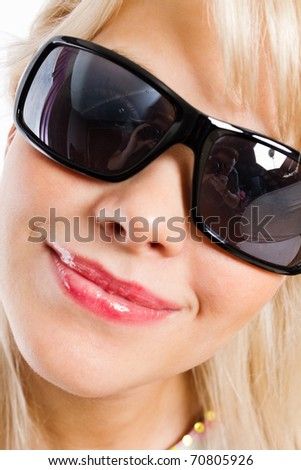 Closeup portrait of a lovely young woman wearing sunglasses - stock photo