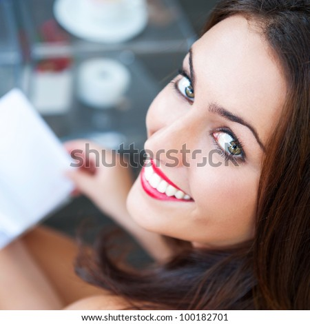 Closeup portrait of a lovely young woman writing a diary - stock photo