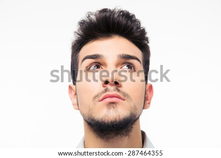 Closeup portrait of a man looking up at copyspace isolated on a white background - stock photo