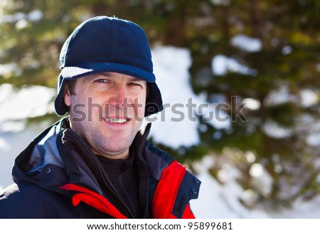 Closeup portrait of a man outdoor in the winter - stock photo