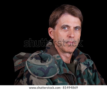 Closeup portrait of a middle aged army veteran at rest.