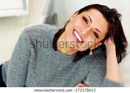 Closeup portrait of a middle-aged cheerful woman  - stock photo