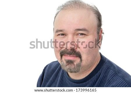 Closeup portrait of a middle-aged man with a speculative look looking pensively at the camera isolated on white - stock photo