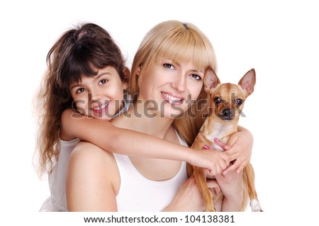 Closeup portrait of a mother, her daughter and their small dog isolated on white - stock photo