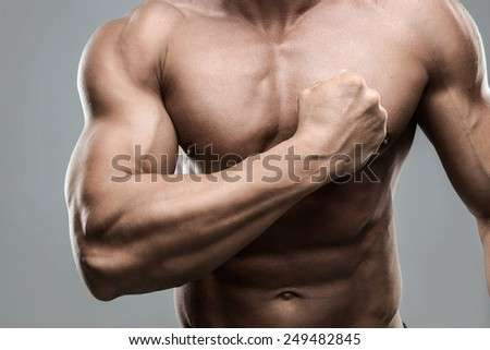 Closeup portrait of a muscular man beating his chest - stock photo