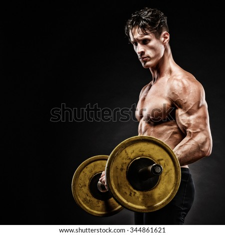 Closeup portrait of a muscular man workout with barbell at gym. Brutal bodybuilder athletic man with six pack, perfect abs, shoulders, biceps, triceps and chest. - stock photo