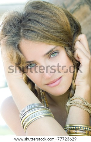 Closeup portrait of a natural young blond smiling - stock photo