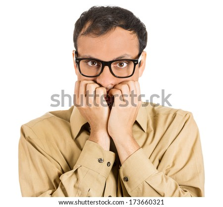 Closeup portrait of a nerdy guy, anxious man with big glasses, biting his finger nails craving something scared, looking at you isolated on white background. Negative human emotion, facial expressions - stock photo