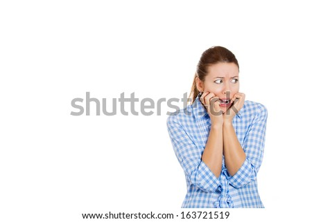 Closeup portrait of a nervous woman biting her nails, looking to the side craving for something, anxious, in anticipation of something bad to happen, isolated on white  background with copy space.
