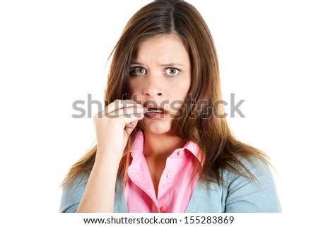 Closeup portrait of a nervous woman eating her hair craving for something or anxious, isolated on white background - stock photo