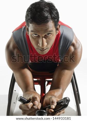 Closeup portrait of a paraplegic cycler against white background - stock photo