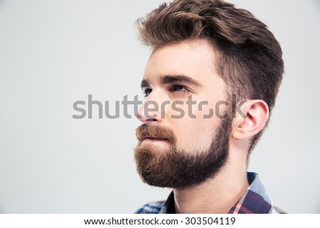 Closeup portrait of a pensive man looking up isolated on a white background - stock photo