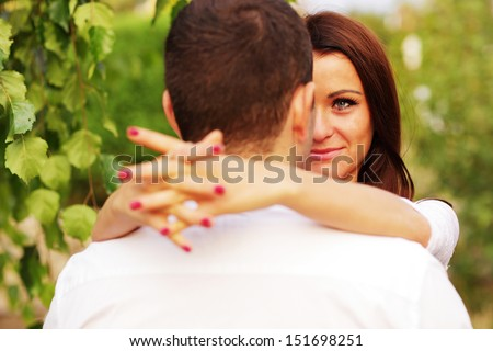 Closeup portrait of a romantic couple in the park - stock photo