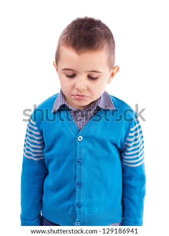 Closeup portrait of a sad little boy isolated on white background - stock photo