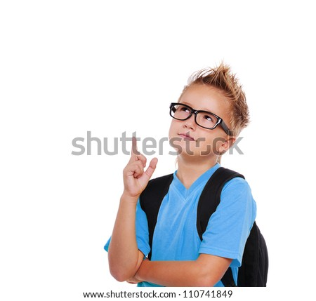 Closeup portrait of a schoolboy in glasses pointing to the copy space area  isolated on white - stock photo