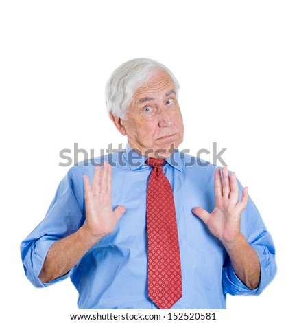 Closeup portrait of a senior executive man with hands up, surprised, puzzled, unhappy, asking to calm down and think , isolated on white background. Human emotions during conversation. Conflict. - stock photo