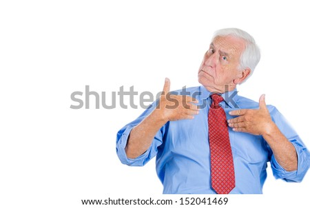 Closeup portrait of a senior man pointing at himself as if to say, you mean me, you talking to me? Isolated on white background with copy space - stock photo