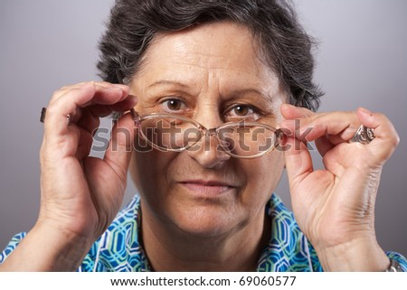 Closeup portrait of a senior woman with glasses