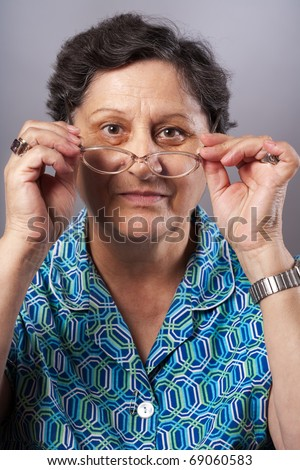 Closeup portrait of a senior woman with glasses - stock photo