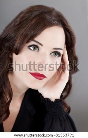 Closeup portrait of a sensuous middle aged woman looking away