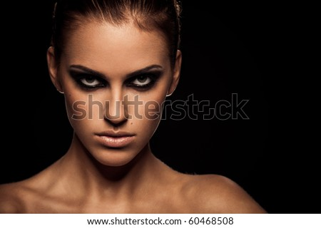 Closeup portrait of a serious lady with smoky eye makeup