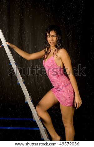 Closeup  portrait of a sexy woman in water studio - stock photo