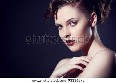 Closeup portrait of a sexy young caucasian woman with red lips - stock photo