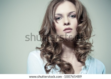 Closeup portrait of a sexy young woman with curly hair and perfect skin - stock photo