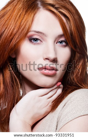 Closeup portrait of a sexy young woman with red hair and natural makeup - stock photo