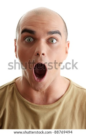 Closeup portrait of a shocked young man looking straight on a white background - stock photo