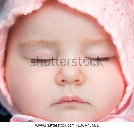 Closeup portrait of a sleeping baby - stock photo
