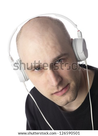 Closeup portrait of a smart mid adult man listening to music against white background,