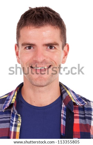Closeup portrait of a smiling casual young man on white background - stock photo