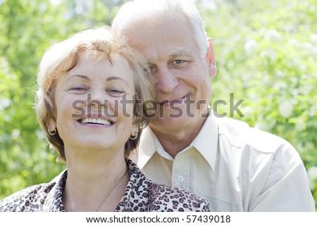 Closeup portrait of a smiling cute senior couple - stock photo