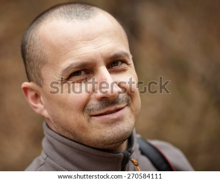 Closeup portrait of a smiling handsome man outdoor