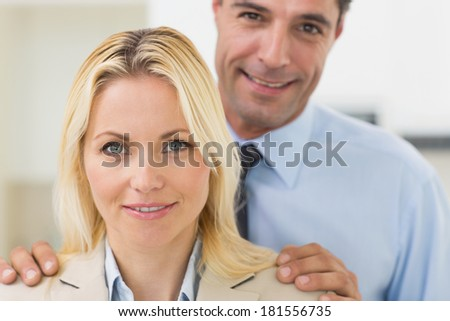 Closeup portrait of a smiling woman and man in the kitchen at home - stock photo