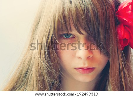 Closeup Portrait of a Teenage Girl with long bang; toned effect - stock photo