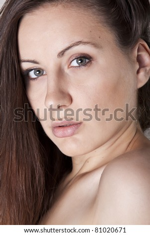 Closeup portrait of a topless young sexy woman - stock photo