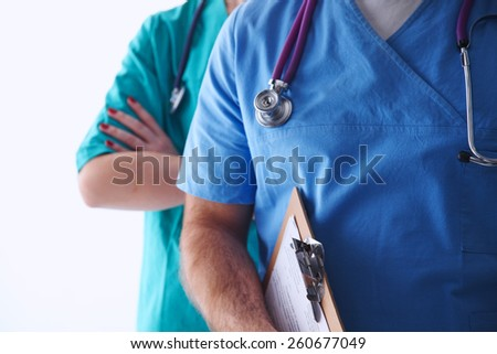 Closeup portrait of a two  doctors with stethoscope - stock photo