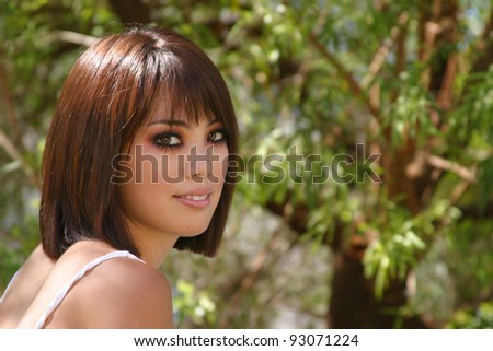 Closeup portrait of a very beautiful Asian woman in  a natural outdoor environment. - stock photo